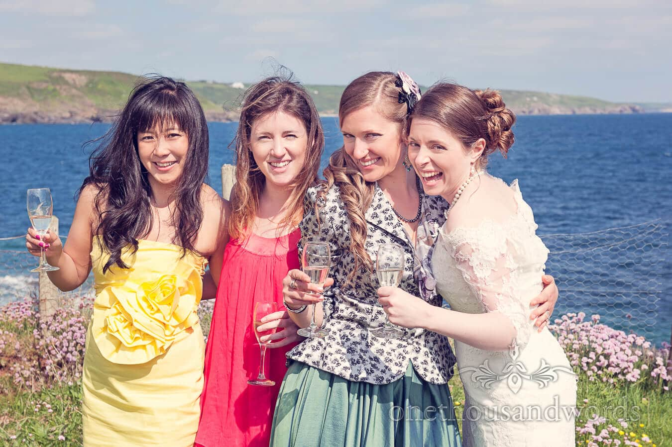 Bride and the girls by the sea at Prussia Cove Wedding Photographs