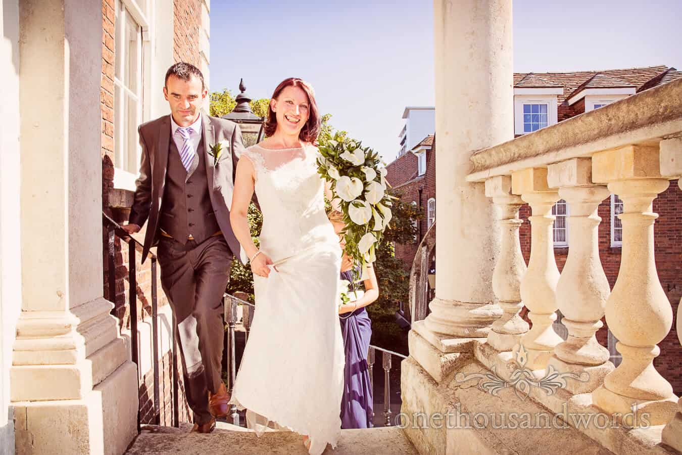 Bride arrives at Poole Guildhall with white wedding flowers