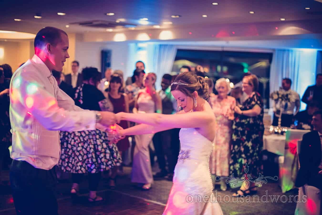 Bride dances with groom at Harbour Heights, Poole wedding venue