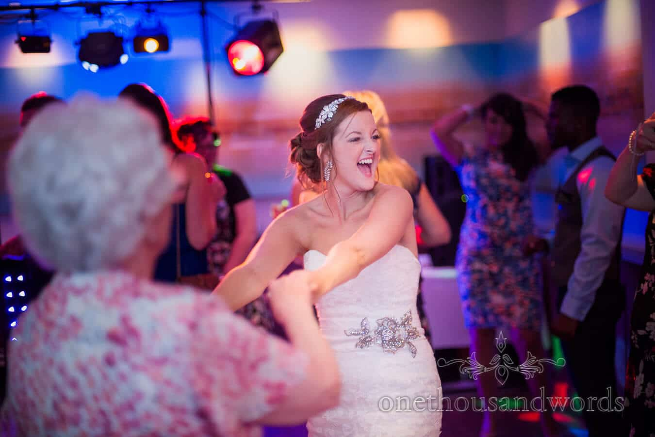 Bride dancing in evening at Harbour Heights, Poole wedding venue