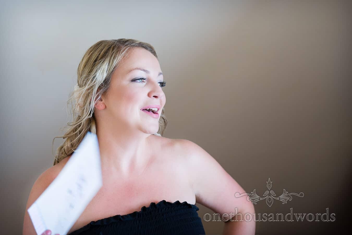 Bride fanning herself at Dorset Home Wedding morning