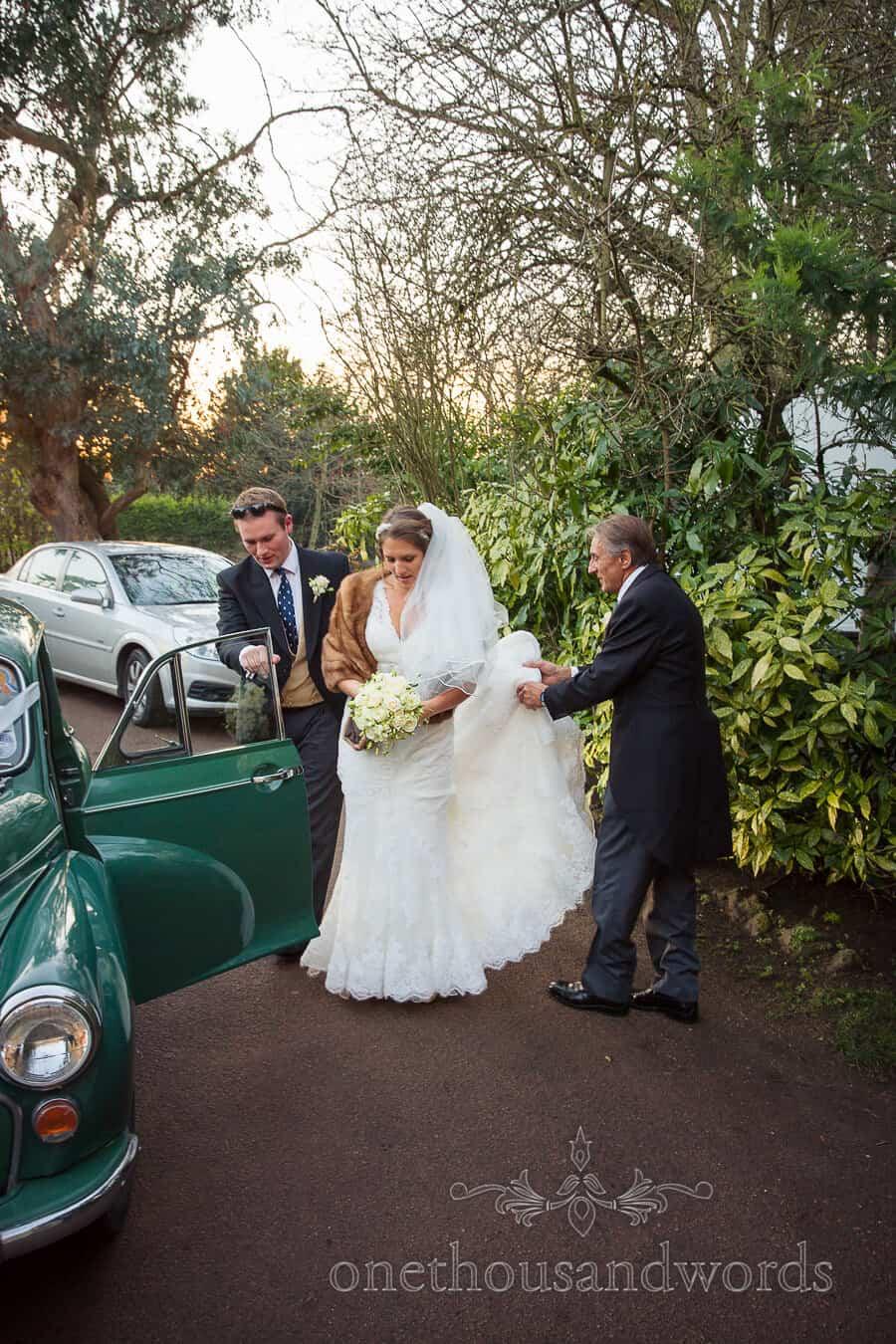 Bride & Groom arrive at Hampton Court House Wedding Reception