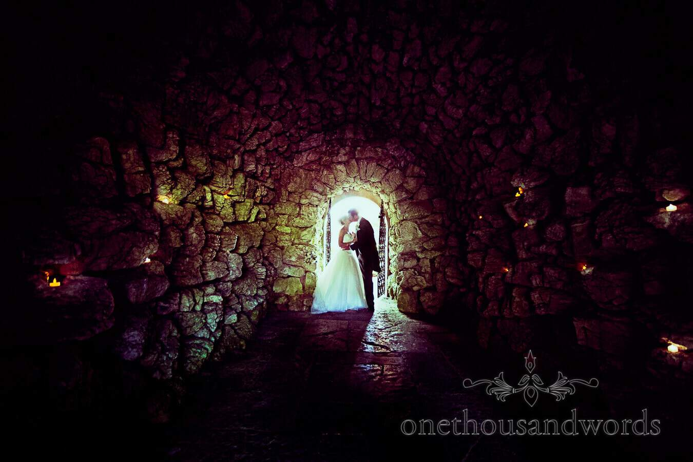 Bride and groom in the grotto at Italian Villa Wedding venue