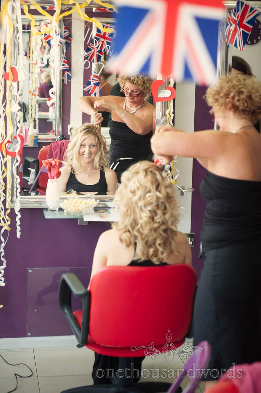 Bride has hair styled in Christchurch on Highcliffe Castle wedding morning