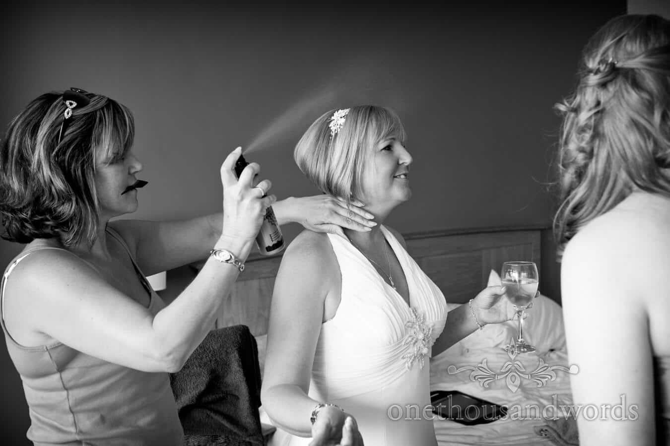 Bride has hair styled on beach theme wedding morning