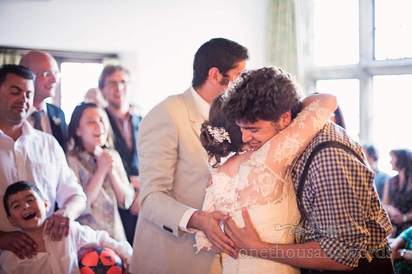 Bride hugs wedding guest at Prussia Cove Wedding venue