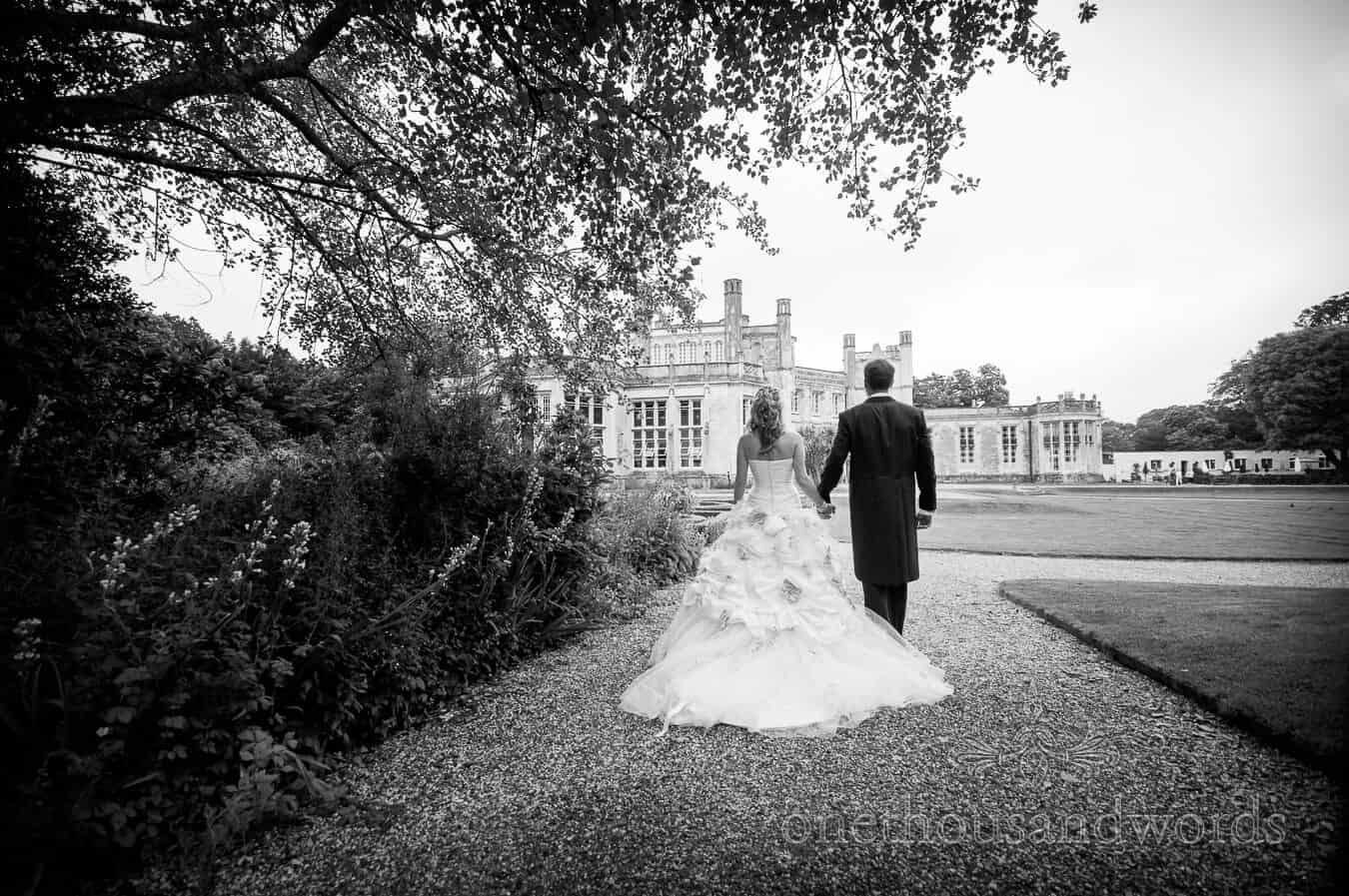 Bride in Ian Stuart wedding dress at Highcliffe Castle wedding venue