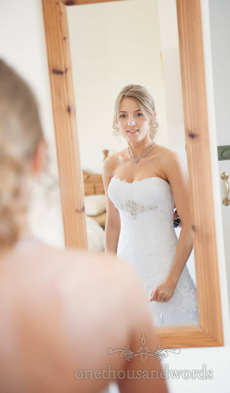 Bride in white flower pattern wedding dress with diamonte detail