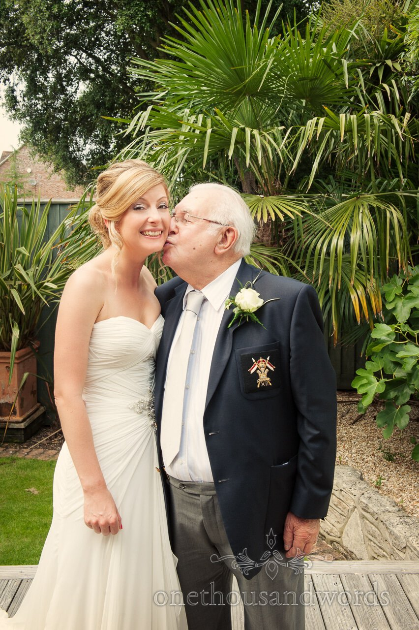 Bride kissed by her grandfather at Lord Bute Wedding Photographs