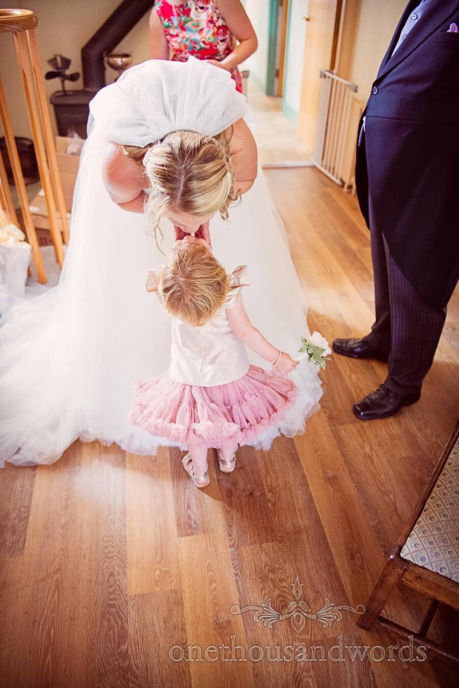 Bride kisses flower girl at Dorset Home Wedding morning