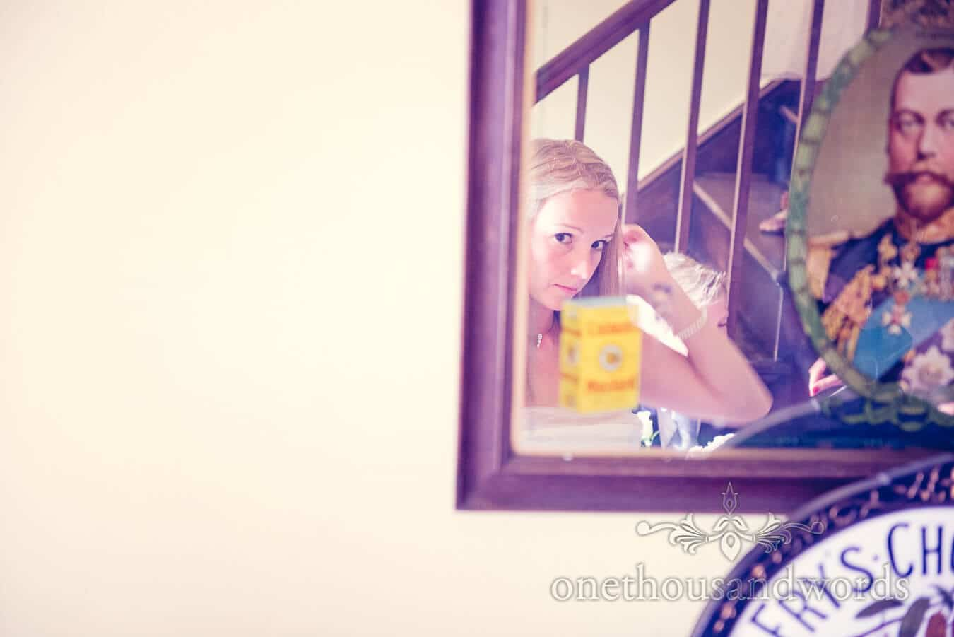 Bride looks in antique mirror on Countryside Wedding morning