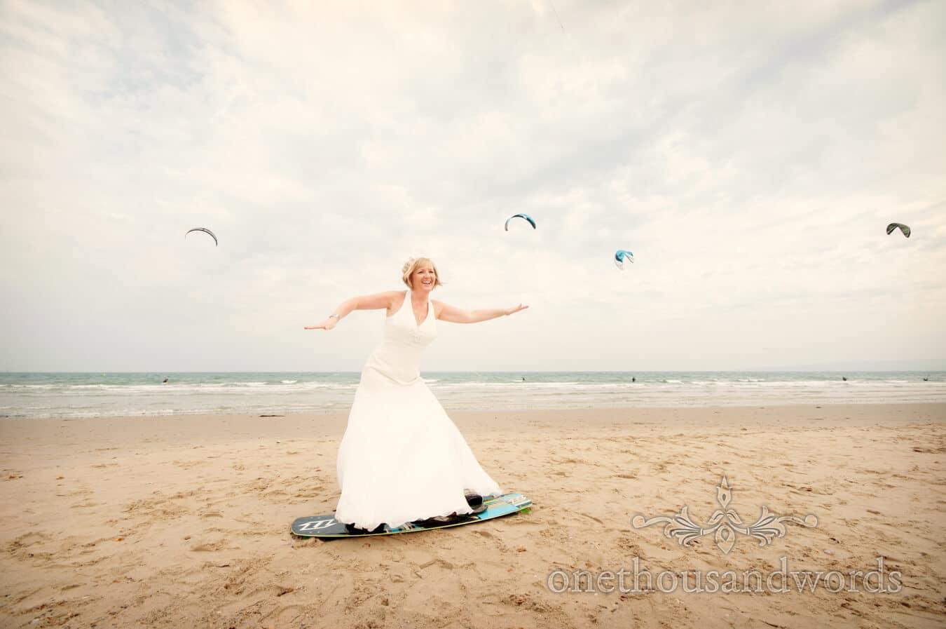 Bride on kiteboard at beach theme wedding in Dorset