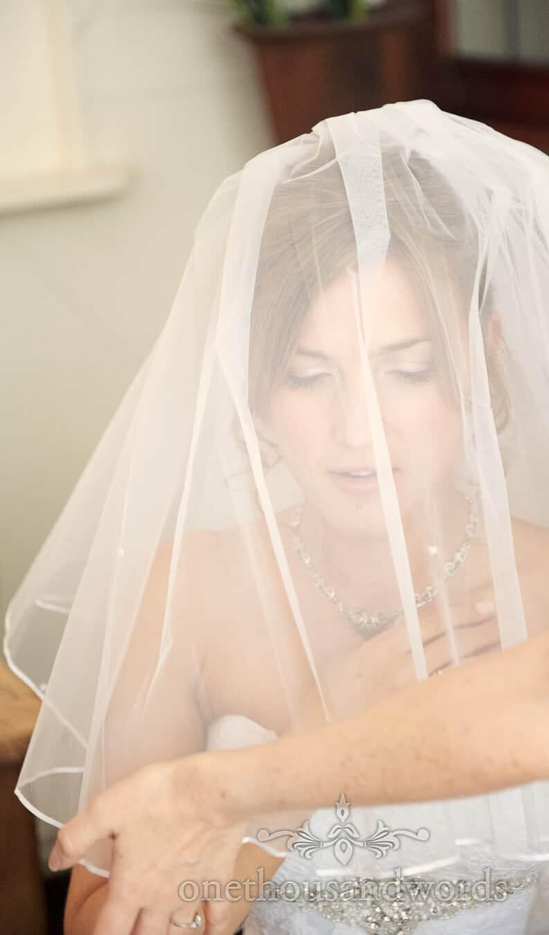 Bride portrait photograph through wedding veil