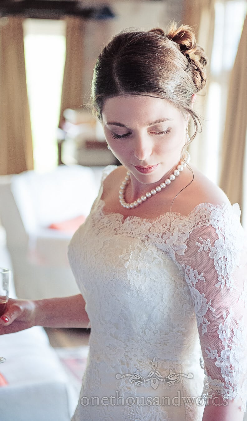Bride portrait photograph with wedding perals at Prussia Cove Wedding