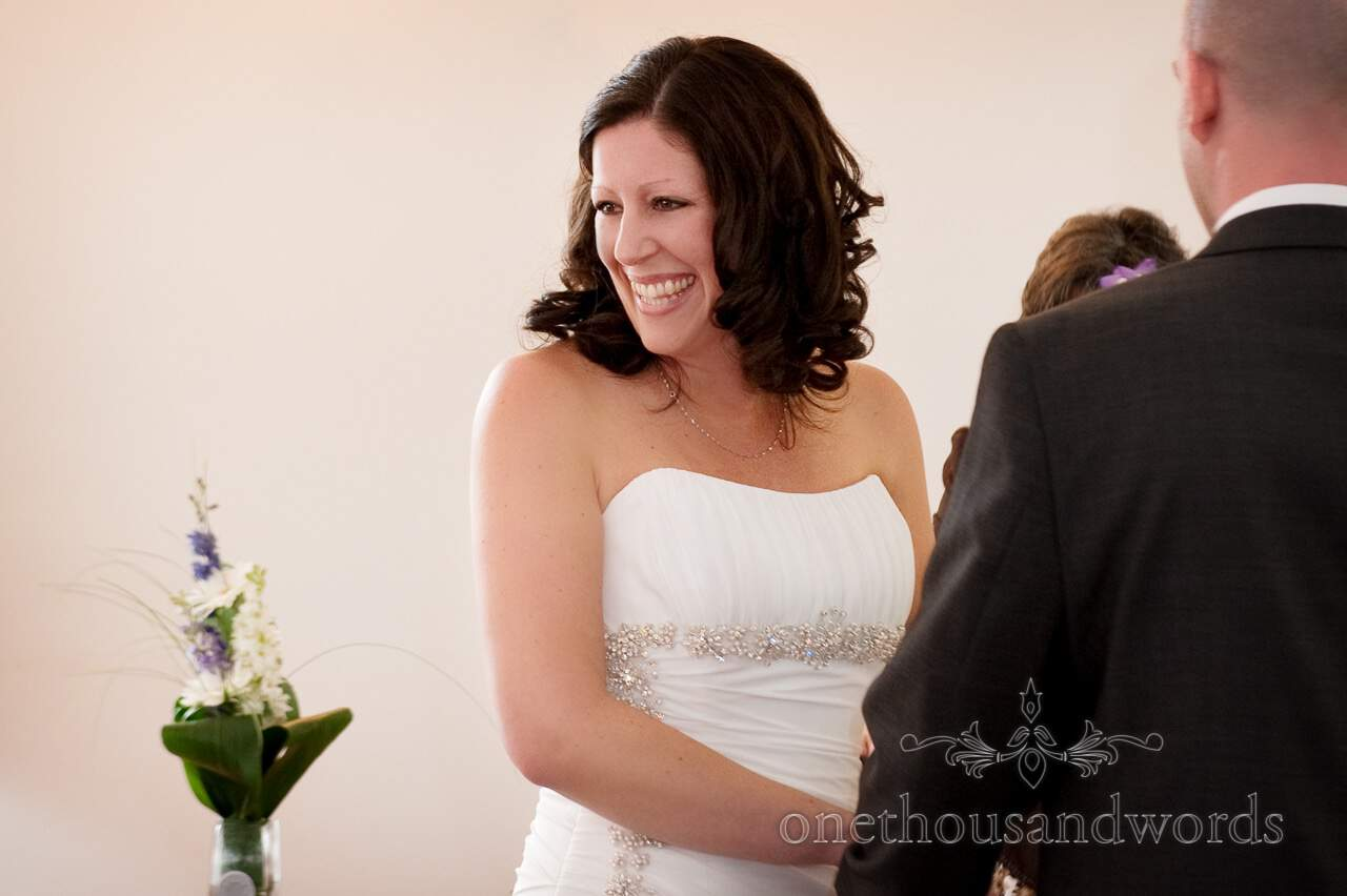 Bride smiles at guests during wedding ceremony