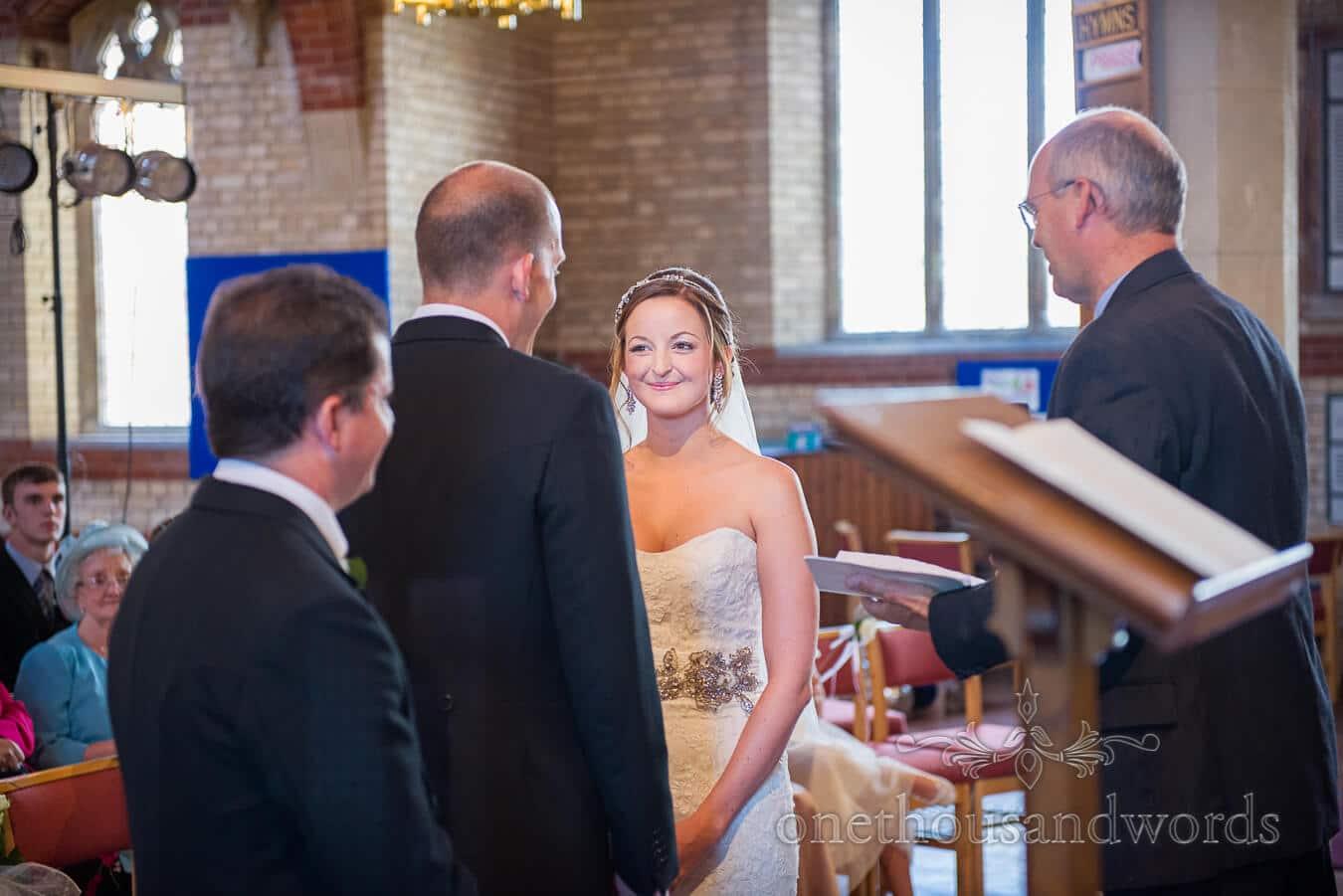 Bride smiling in church at Poole wedding venue ceremony