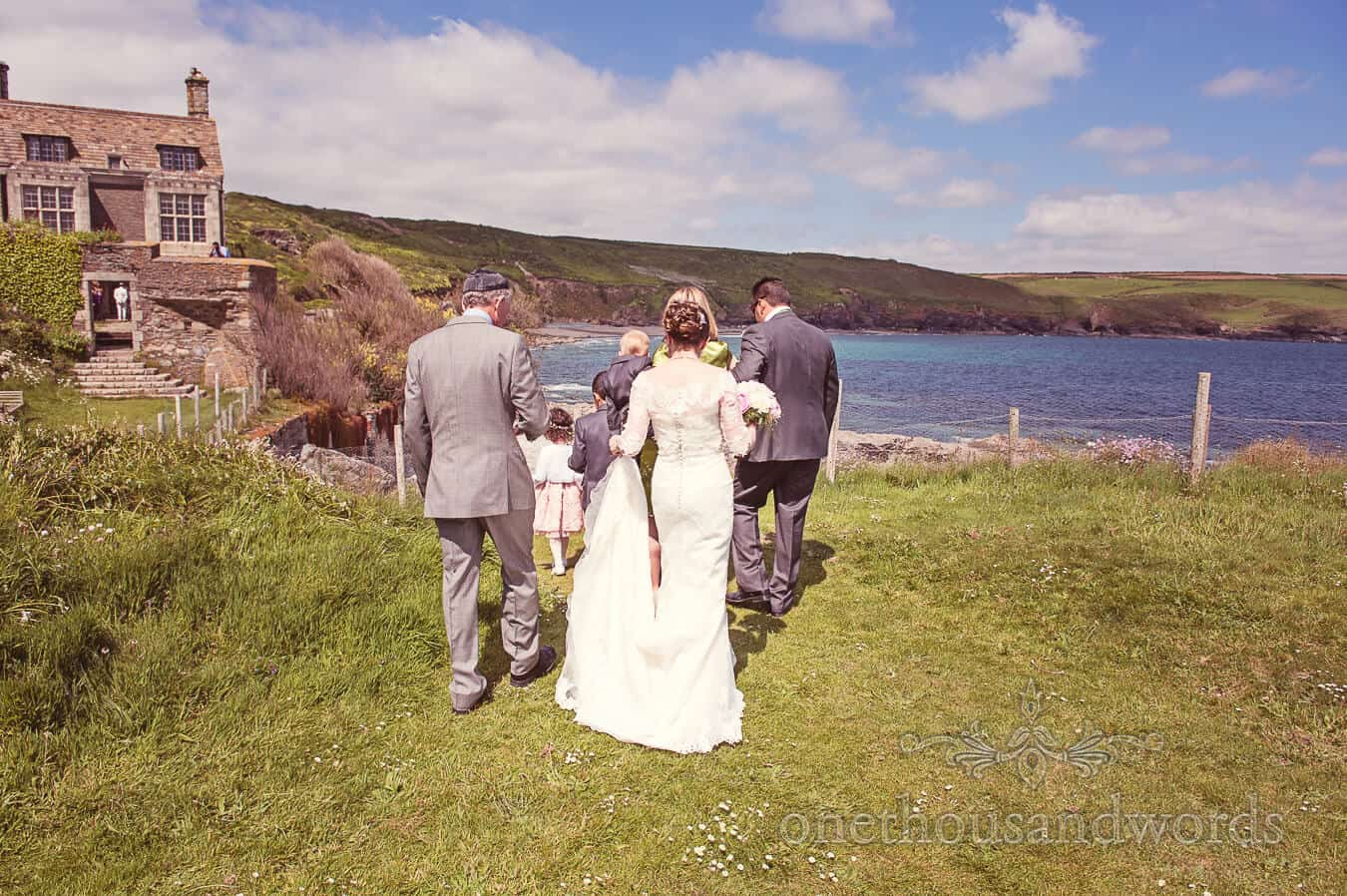 Bride walks by the sea to her Prussia Cove Wedding ceremony
