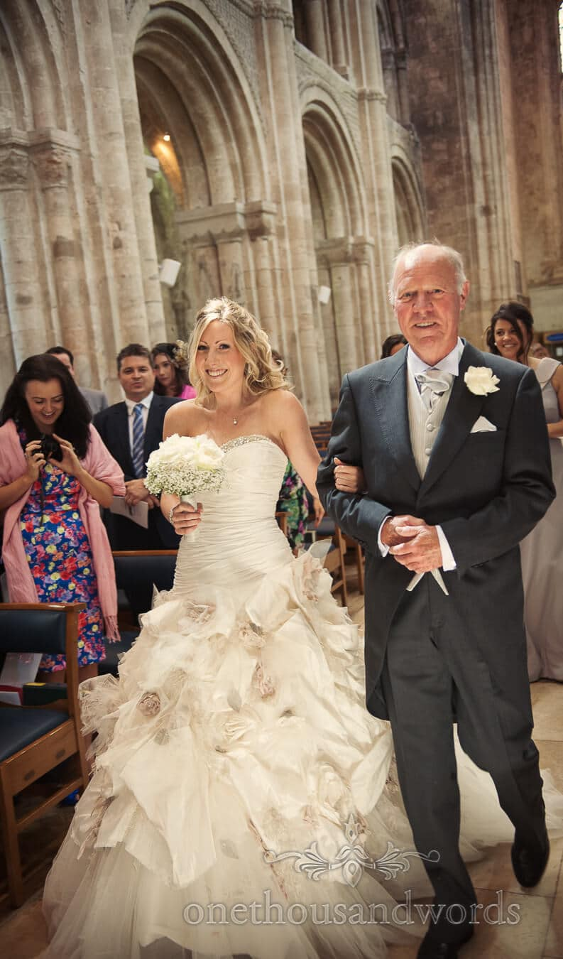Bride wears Ian Stuart at Christchurch Priory wedding ceremony