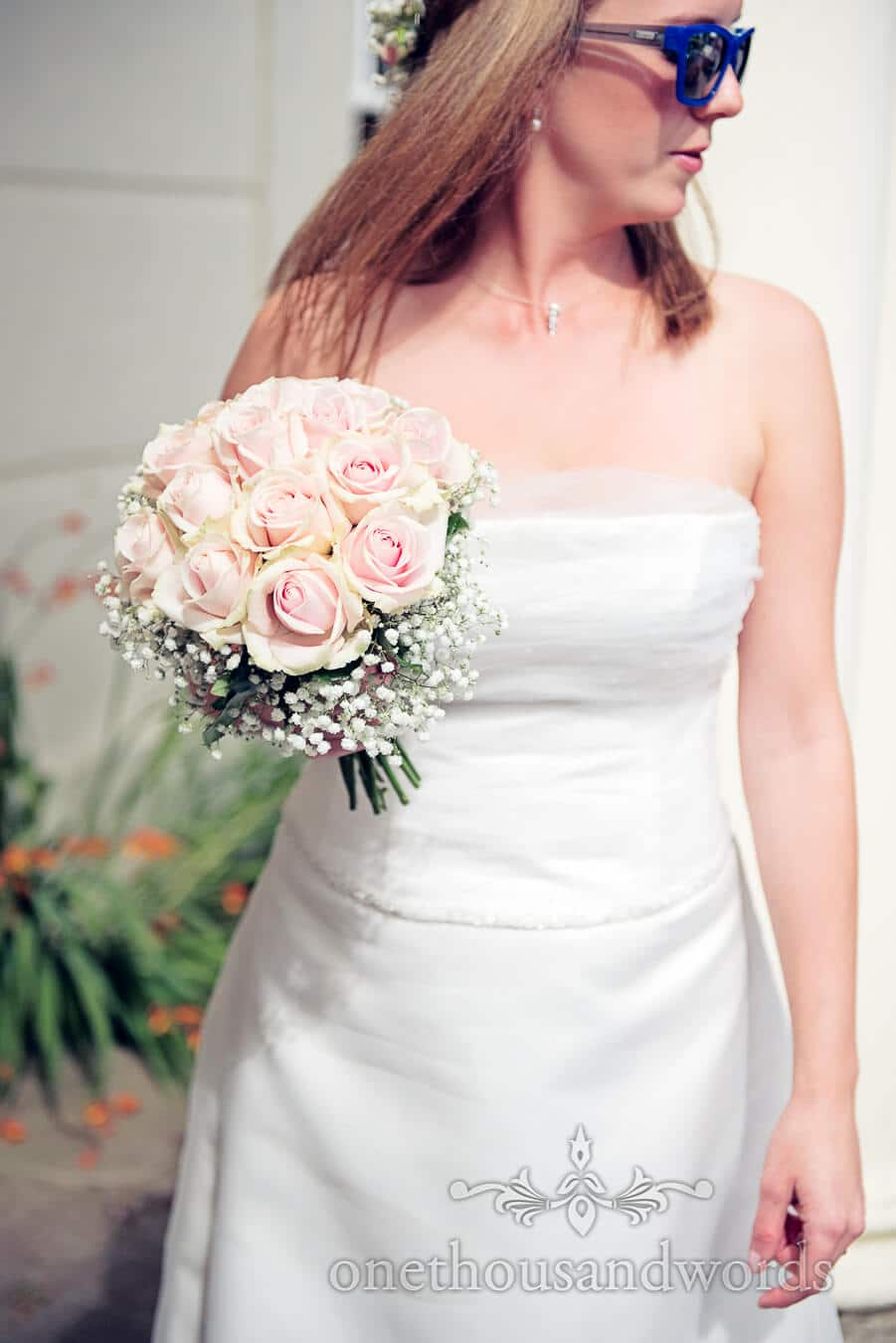 Bride with pink rose wedding bouquet at Countryside Wedding Photograph