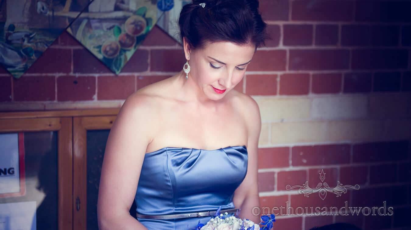 Bridesmaid in blue bridesmaids dress at Tenbury Wells Wedding ceremony