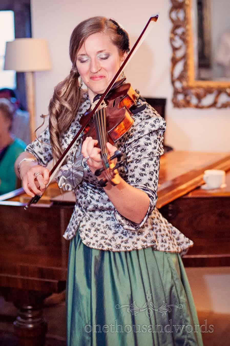 Bridesmaid plays violin at Prussia Cove Wedding