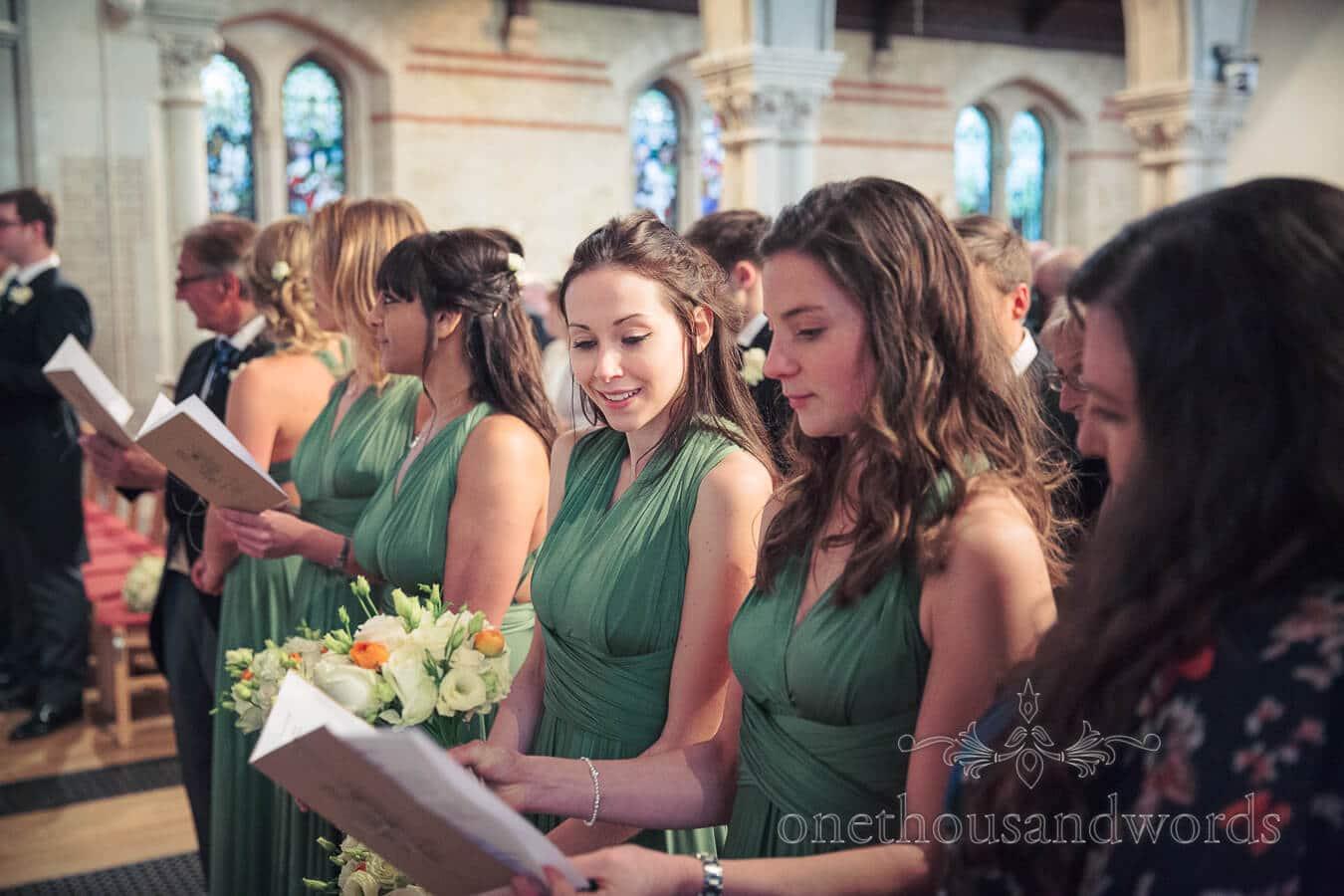 Bridesmaids in Green Bridemaid Dresses at Richmond Church Wedding Ceremony