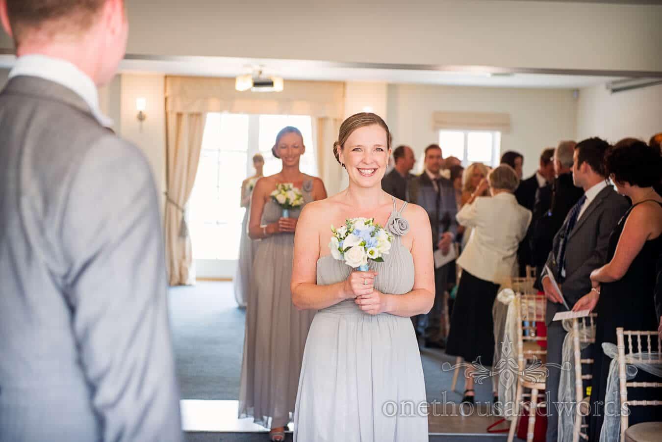 Bridesmaids walk down aisle at Italian Villa Wedding Ceremony