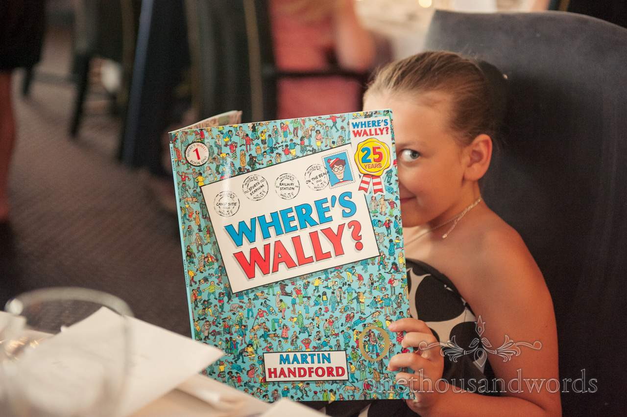 Child wedding guest with Where's wally? Book at Lord Bute wedding