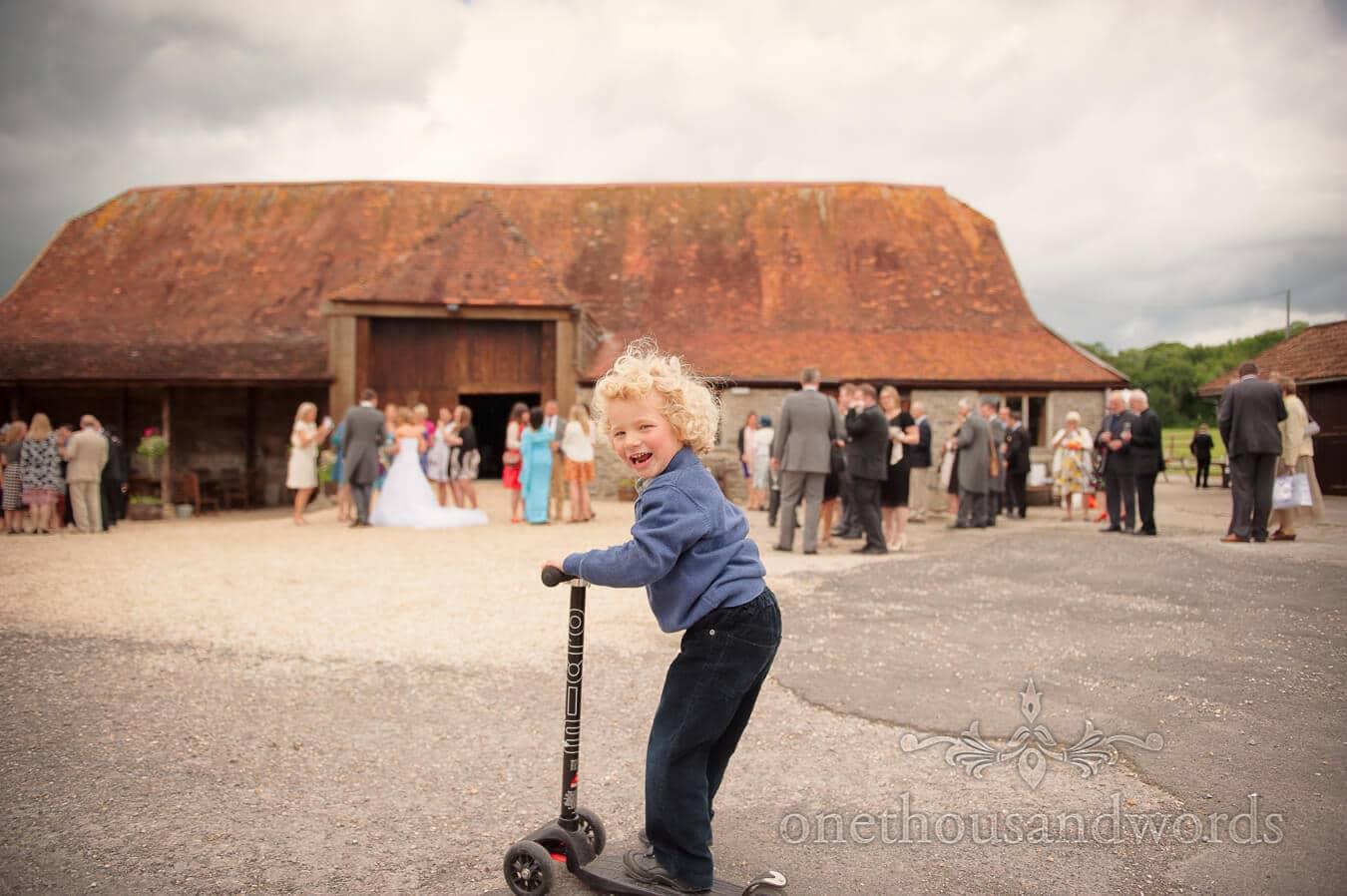 Child wedding guests plays at Stockbridge Farm Barn Country Theme Wedding