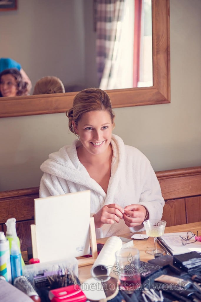 Happy bridesmaid in white towel dressing gown on wedding morning