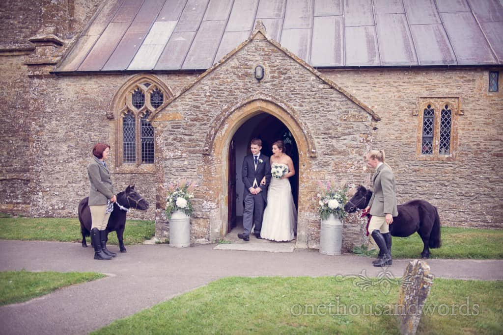 ponies outside church at countryside themed wedding