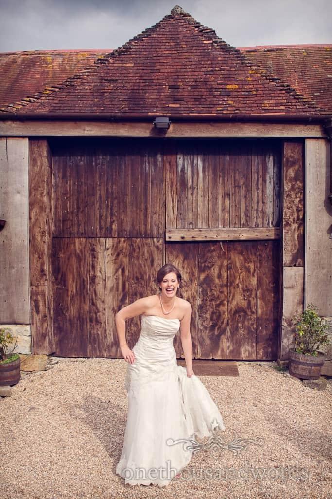 Bride outside Stockbridge Farm Barn countryside wedding venue in Dorset