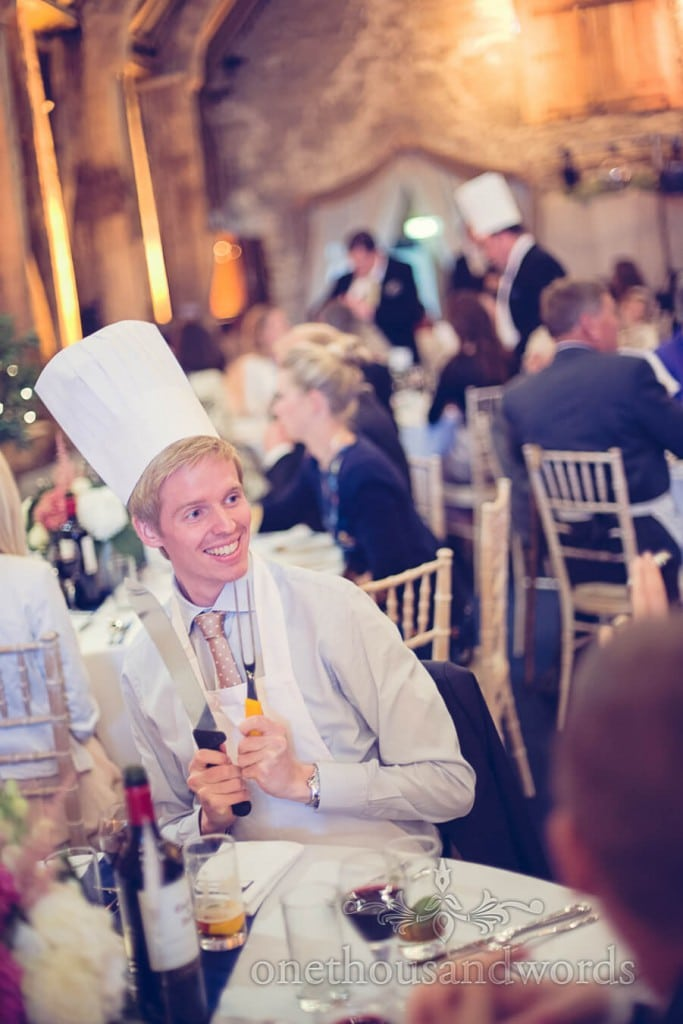 Wedding guest in white chefs hat prepares to calve wedding breakfast