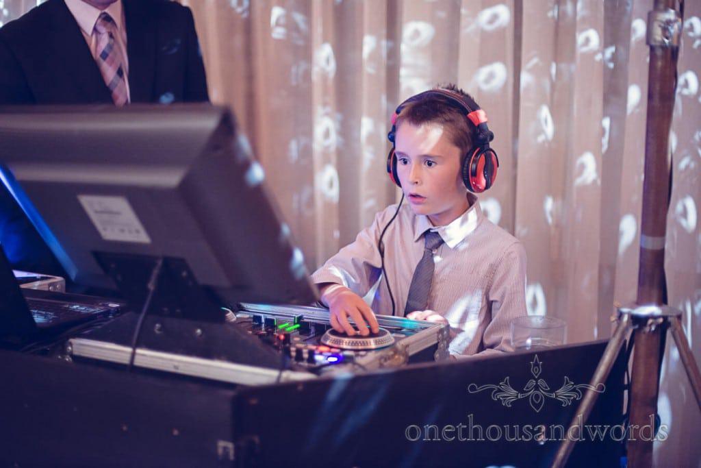 Child wedding guest has a go at being a wedding DJ with CD decks