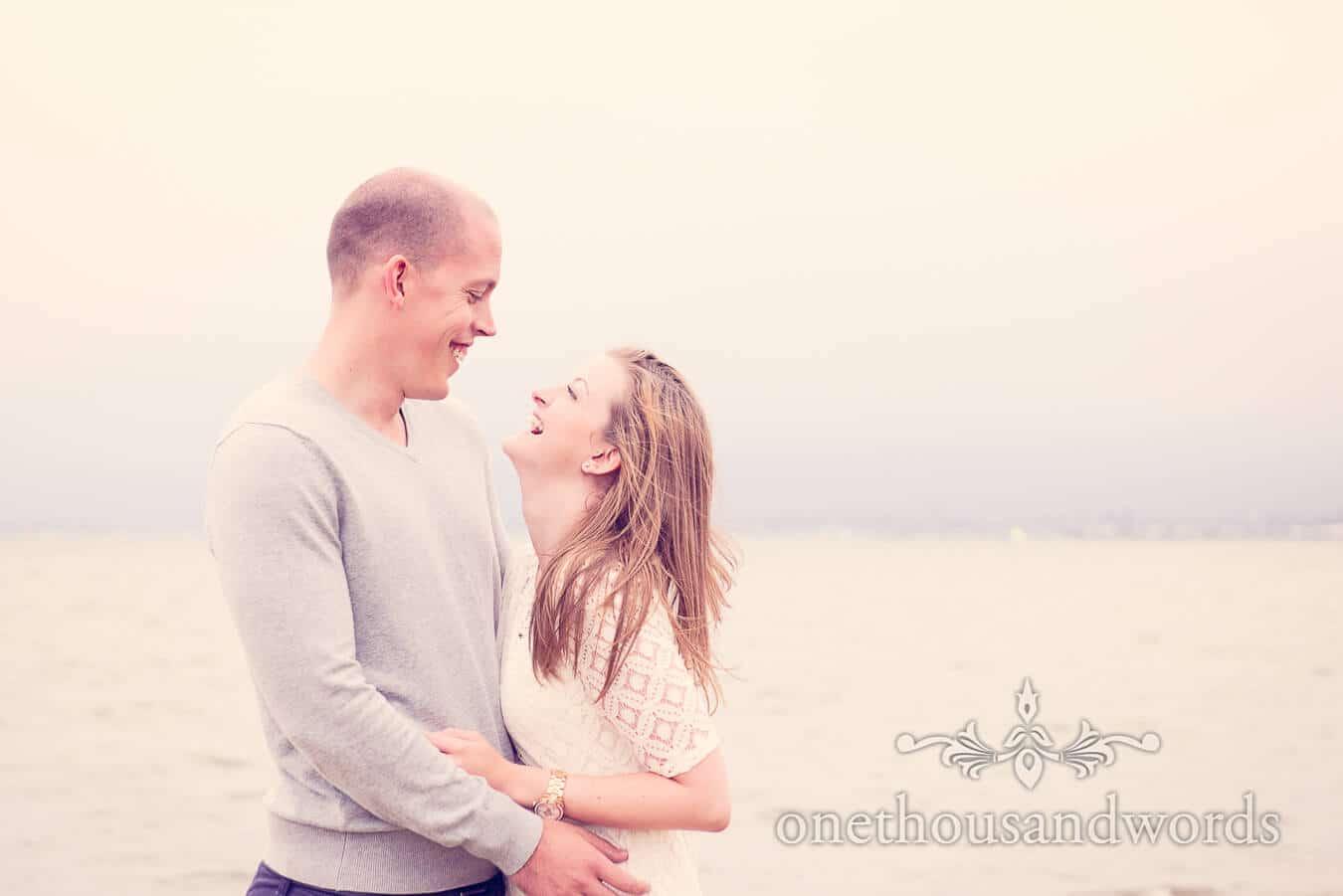 Engagement couple laughing at Sandbanks in Dorset