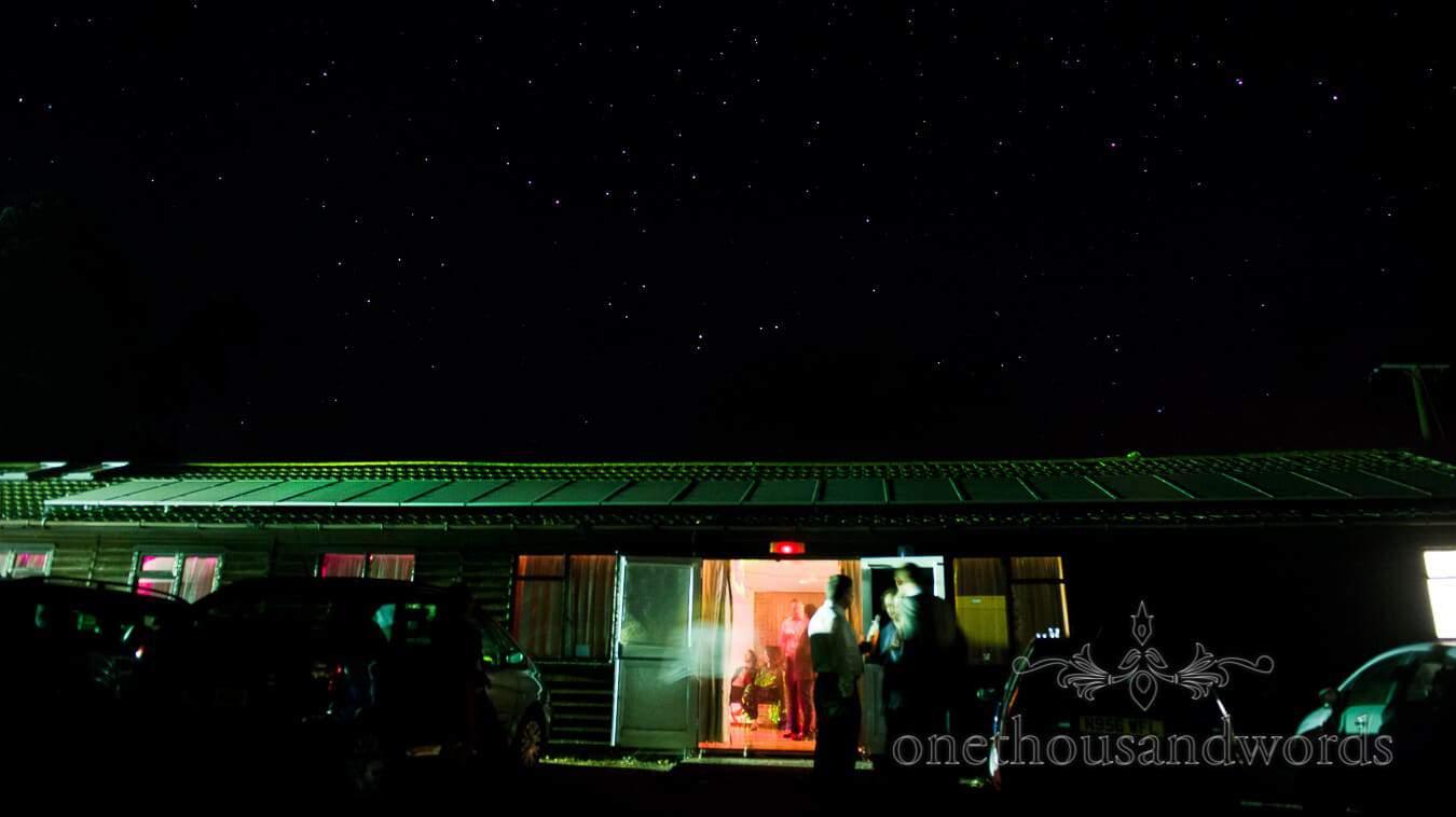 Cricket club wedding cenue at night with stars