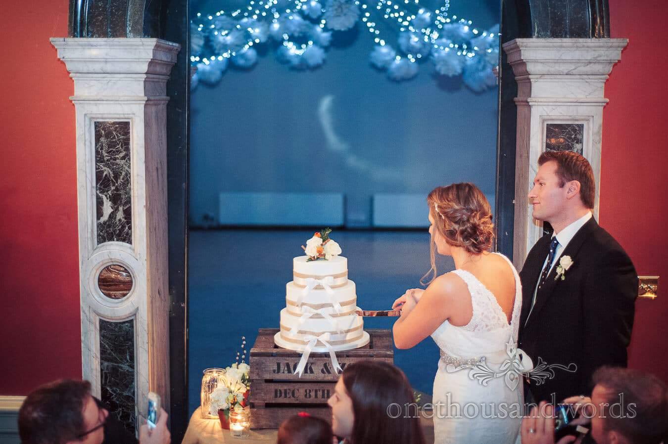 Cutting the Cake at Hampton Court House Wedding