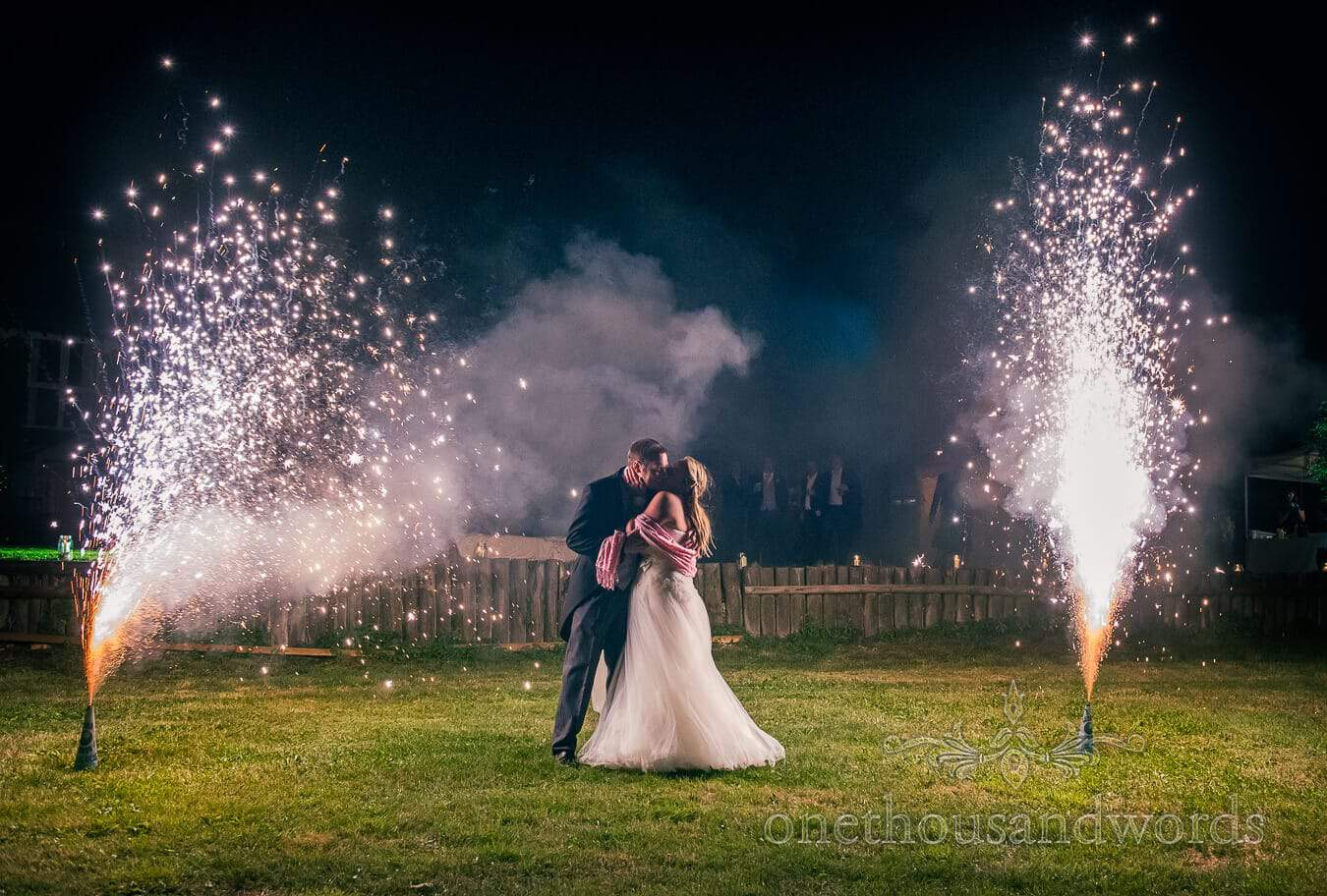 Dorset Home Wedding fireworks with bride and groom kissing