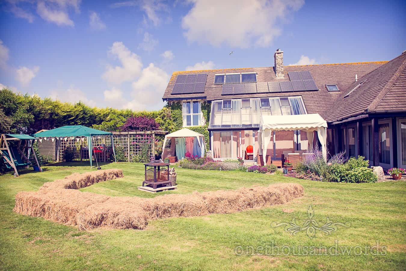 Dorset Home Wedding venue with fire and staw bales in Martinstown, Dorset