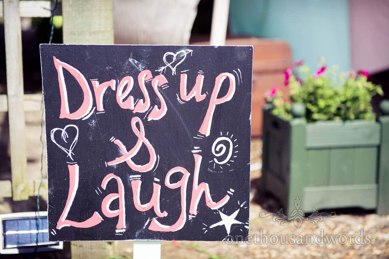 Dress up and Laugh weddinggn sign at Dorset Home Wedding