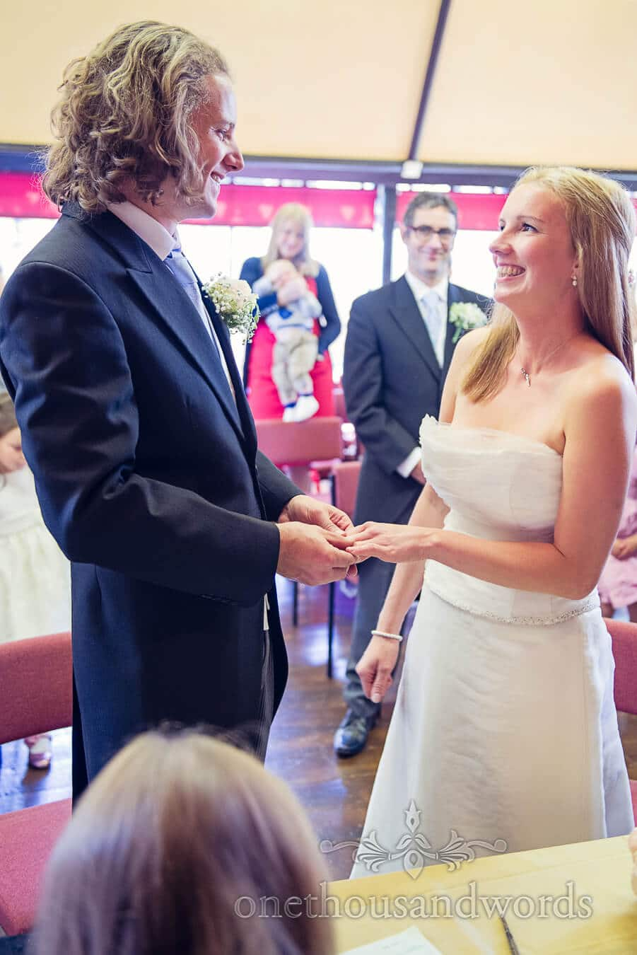 Exchange of rings at Tnebury Wells Pump Rooms wedding ceremony
