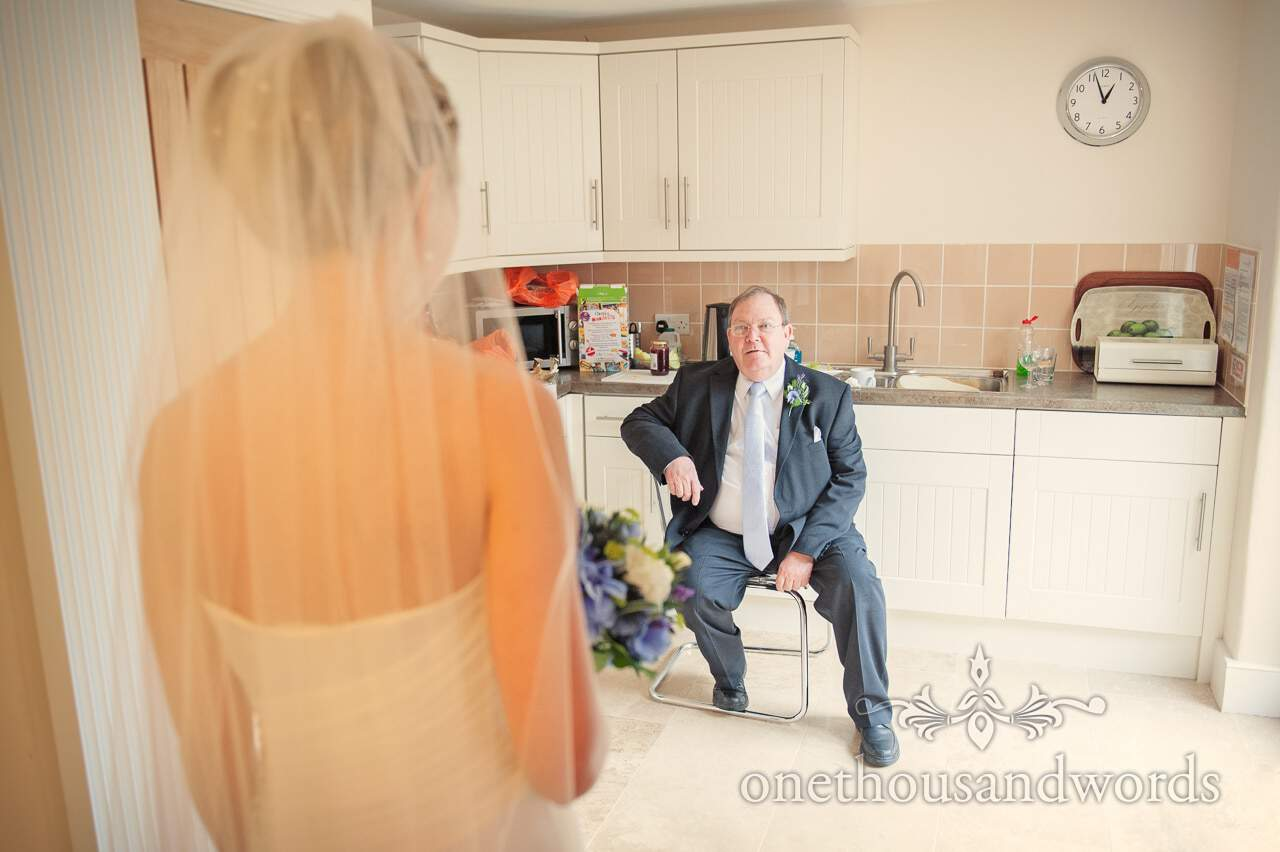 Father of bride sees bride in dress on wedding morning