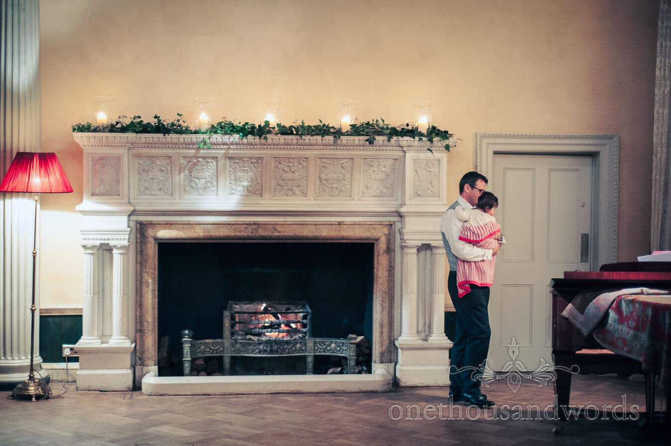 Fireplace and wedding guest at Hampton Court House Wedding Venue