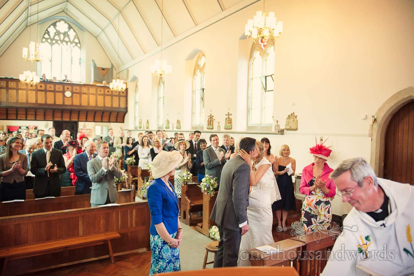 First kiss at church wedding ceremony in Swanage, Dorset