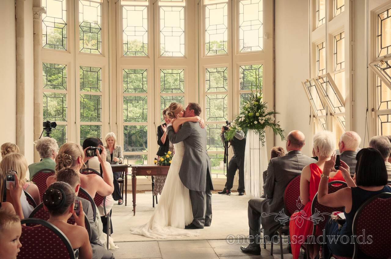 First kiss at Highcliffe Castle wedding ceremony