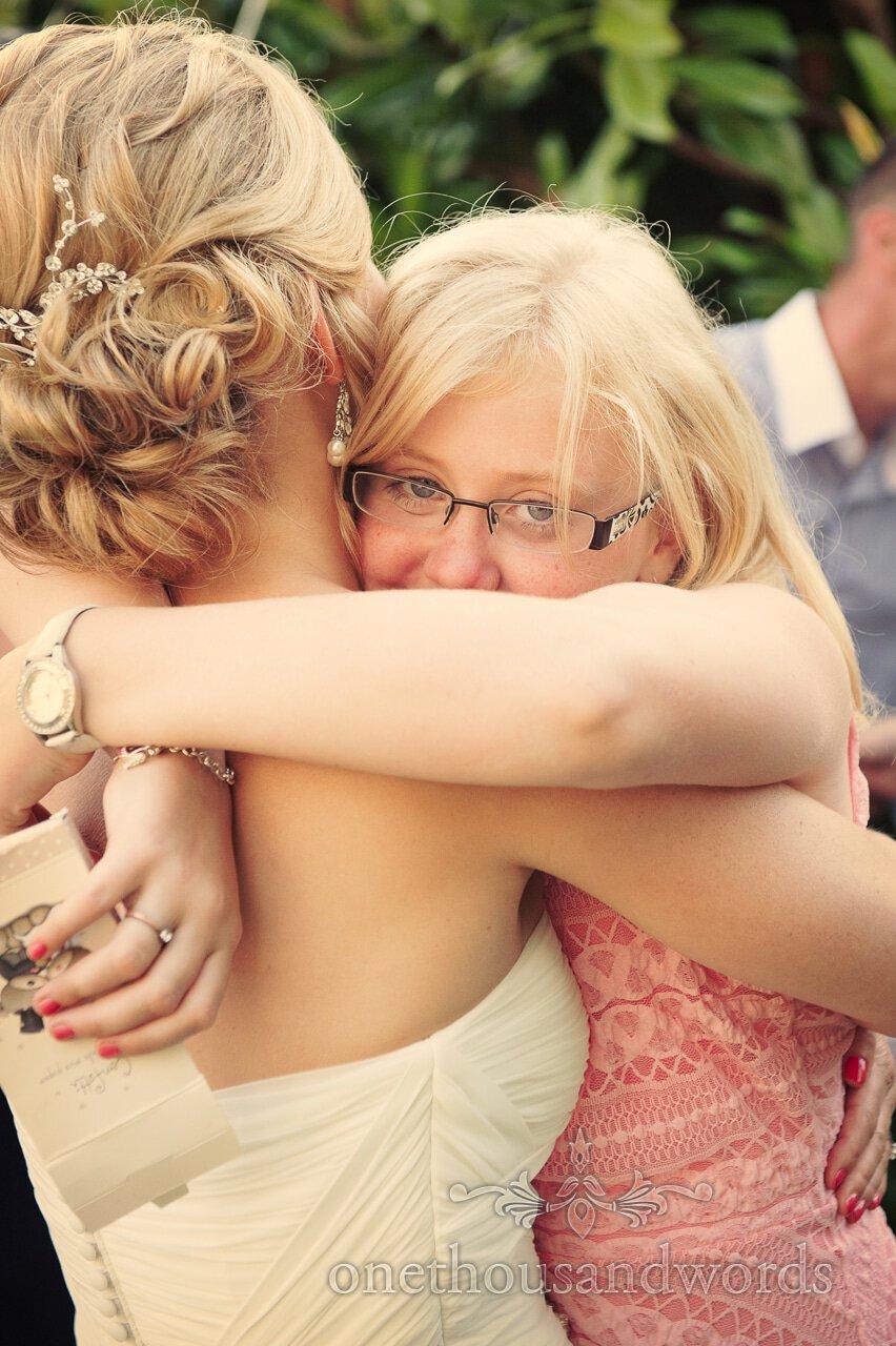Flower Girl hugs bride at Lord Bute wedding