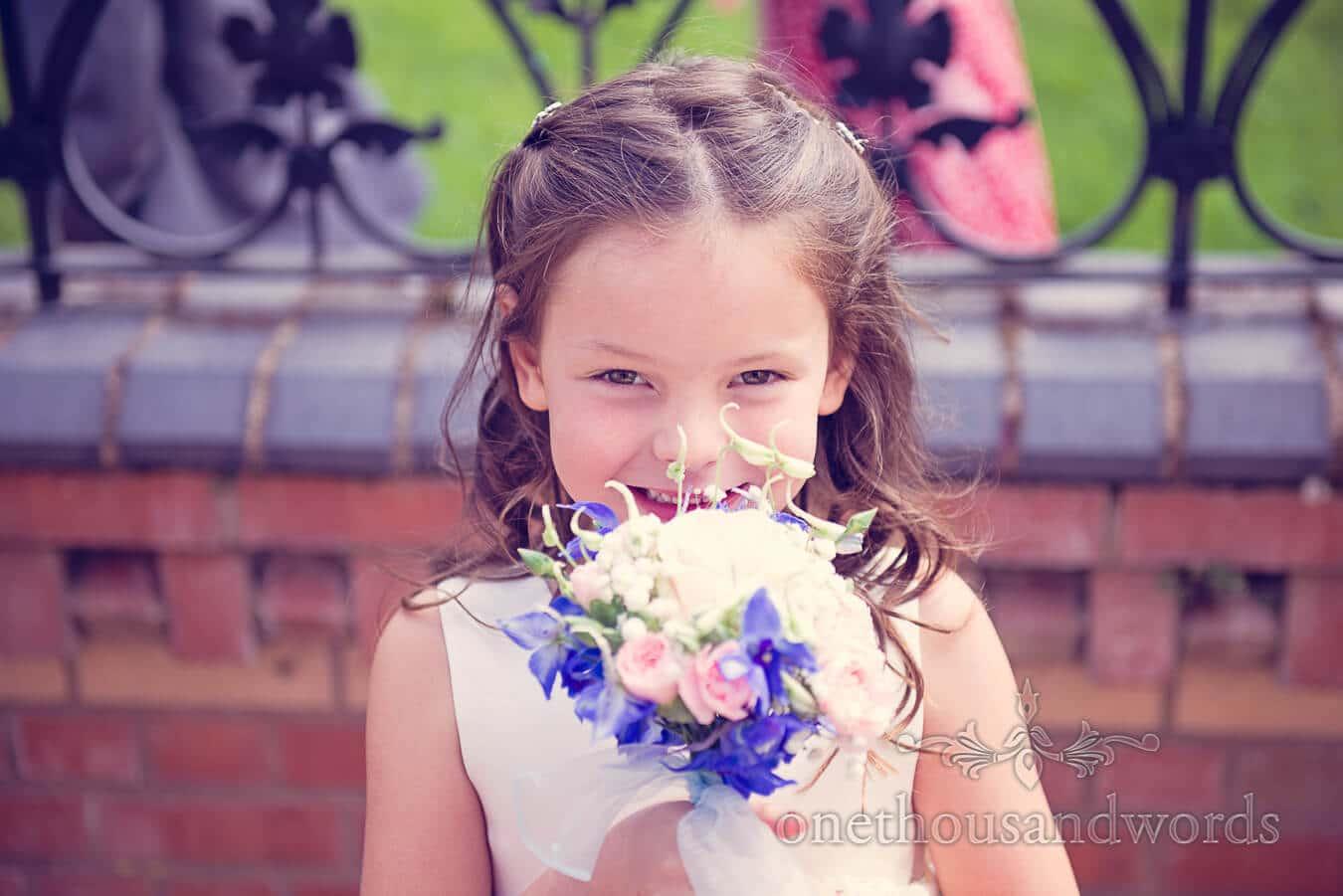 Flower girl portrait photograph with wedding bouquet