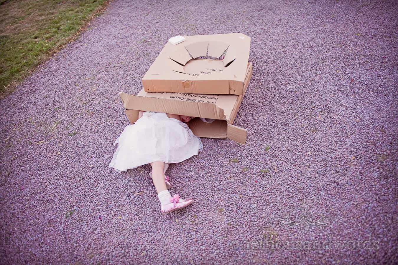 Flower girl randomly hides in a box at Countryside Wedding