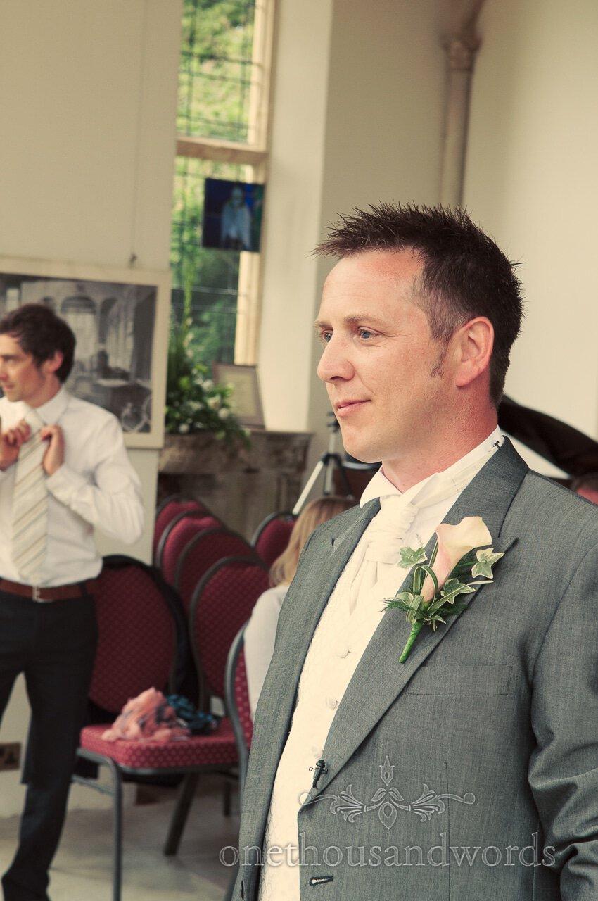 Groom awaiting bride at Highcliffe Castle wedding ceremony