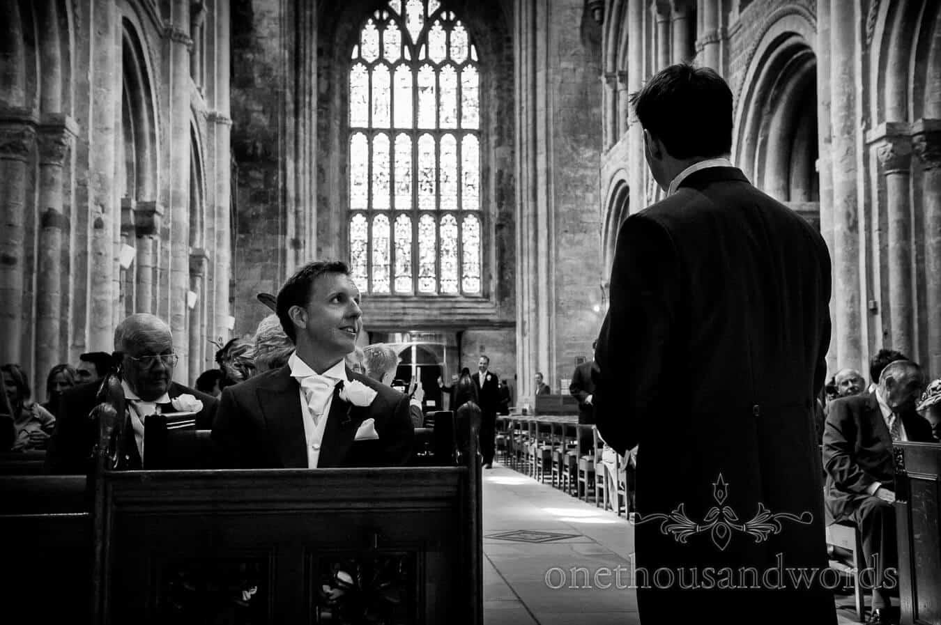 Groom awaits bride at Christchurch Priory wedding ceremony